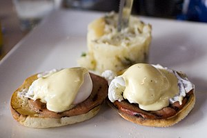 "Eggs Benedict consisting of ""English muffins t..."