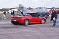 Ferrari F430 2006 Spider drives past Mikoyan-Gurevich MiG-15UTI Midget TICO 13March2010 (14412807370).jpg