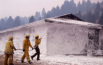 Firefighting foam - Firefighters sprayed foam on structures in the Mammoth Hot Springs complex on 10 September 1988 during the Yellowstone Fires.