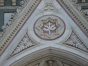 Santa Croce, Florence - Franciscan symbol on the facade of the temple
