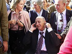 Francisco Fernández Ochoa in a crowd, talking on a cellphone.jpg