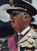 Top of an elderly man in a military uniform and dark glasses