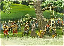 The Frankburger Würfelspiel has forced each two men to play for their life throwing the dice below the rope hanging from the tree that would be used to immediately hang the one who loses – a priest is nearby for a last prayer and a line of Bavarian soldiers guard the scene from the large mass in the background