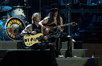 Both bassist Duff McKagan (left) and guitarist Slash (right) returned to the band in 2016. GNRChorzow090718-77 (42227860380) (cropped).jpg