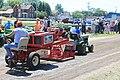 Garden Tractor pulling sled.jpg