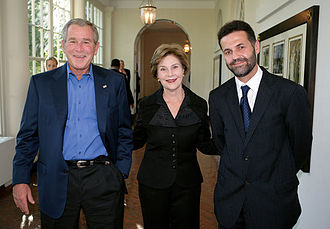Afghan Americans - Khaled Hosseini at the White House in 2007, with Bush and Laura Bush.
