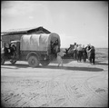 Gila River Relocation Center, Rivers, Arizona. Evacuee agricultural workers are here shown on their . . . - NARA - 538588.tif