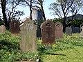 Gravestones and farm buildings - geograph.org.uk - 421558.jpg