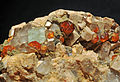Grenat var. spessartine, fluorine, quartz fumé et orthose (Chine).JPG