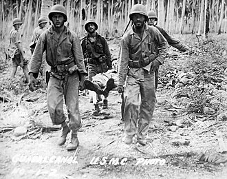 Pacific Ocean theater of World War II - U.S. 5th Marines evacuate injured personnel during actions on Guadalcanal on November 1, 1942.
