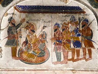 Guru Gobind Singh - A Fresco of Guru Gobind Singh and The Panj Piare in Gurdwara Bhai Than Singh built in the reign of Maharaja Ranjit Singh.