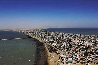Gwadar - Gwadar is located on a narrow and sandy isthmus which connects the 480 foot tall Gwadar Promontory to the Makran coastline.