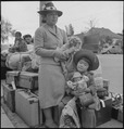 Hayward, California. These people of Japanese ancestry are awaiting the special bus which will take . . . - NARA - 537522.tif