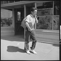 Hayward, California. Youth on relief. High School student carrying home surplus commodities for his family on relief.... - NARA - 532124.tif