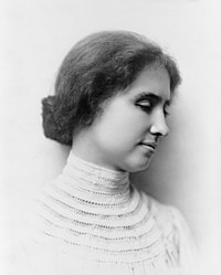 Right semiprofile head and shoulders photo of the young Helen Keller wearing a high-necked crocheted white blouse