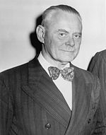 photograph of man in suit and tie