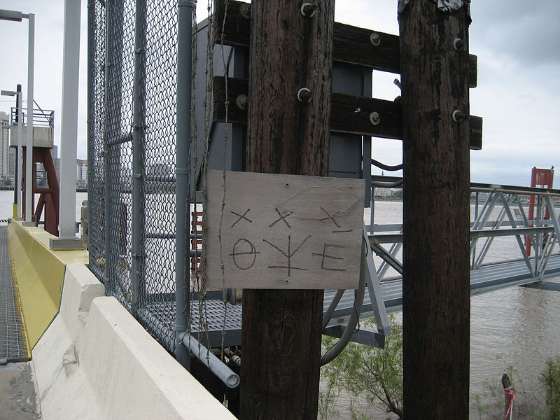 Hobo or tramp markings at Algiers entrance to Canal Street Ferry across Mississippi River, New Orleans.