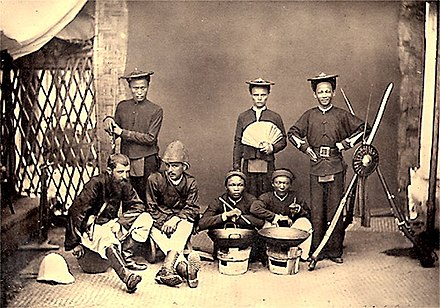 French officers and Tonkinese riflemen, 1884 Hocquard and Tonkinese.jpg