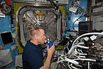 ISS-46 Tim Kopra with gas analyzer in the Quest airlock.jpg