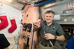 ISS-50 Andrei Borisenko with cookies at Christmas Eve.jpg