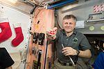 ISS-50 Andrei Borisenko with cookies at Christmas Eve.jpg