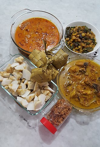 Indonesian cuisine - Opor ayam (curry style), gulai, ketupat, diced potatoes with spices, and fried shallots served during Lebaran (Eid al-Fitr) in Indonesia