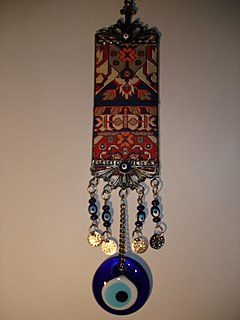 Amulet Object worn in the belief that it will magically protect the wearer