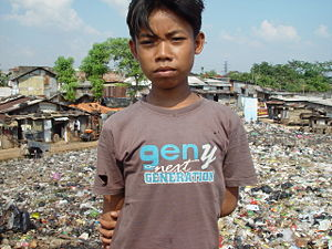 A young boy living on an East Cipinang garbage...