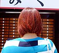 Japanese woman with red bob haircut.jpg