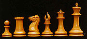 Original Staunton chess pieces by Nathaniel Cook from 1849, left to right: pawn, rook, knight, bishop, queen, and king.