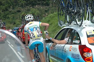 Domestique - A domestique retrieving water for his team mates.