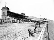B&W photo of a race track grandstand