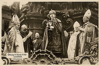 Holy Crown of Hungary - King Charles IV, taking his coronation oath at Holy Trinity Column outside Matthias Church (1916).  To date, he is the last monarch to be crowned with St. Stephen's Crown.  Notice the size difference between the crown and the king's head.
