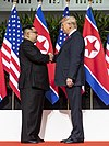 Kim and Trump shaking hands at the red carpet during the DPRK–USA Singapore Summit (cropped).jpg