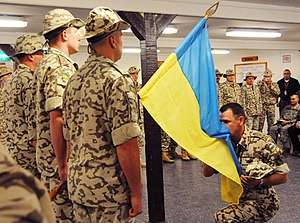 Multi-National Force – Iraq - Henadii Lachkov, commander of the Ukrainian contingent in Iraq, kisses his country's flag