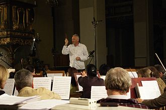 Krzesimir Dębski - Krzesimir Dębski conducting Toruń Symphony Orchestra and Choir Astrolabium during recording session of his own Cosmopolis