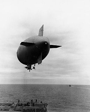 The U.S. Navy blimp L-8 over the aircraft carr...