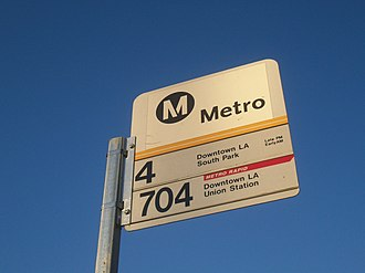 Metro Rapid - Metro bus stop sign for Local line 4 and Rapid line 704 in Santa Monica.