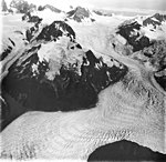 La Perouse Glacier, tidewater glacier icefall, hanging glaciers, and faint banded ogives, August 31, 1977 (GLACIERS 5580).jpg