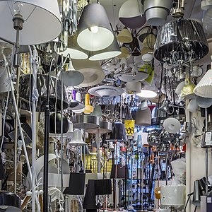 Light fixture - A large number of light fixtures and lamps at a store.