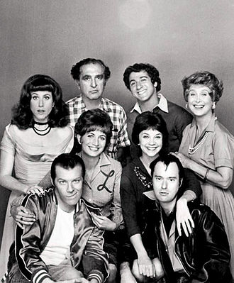 Laverne & Shirley - Cast photo, 1976. Standing, L–R: Carole Ita White, Phil Foster, Eddie Mekka, Betty Garrett. Middle row, standing: Penny Marshall, Cindy Williams. Seated: Michael McKean, David Lander.