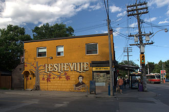 Queen Street (Toronto) - A coffee shop in Leslieville with a mural on it. Queen Street is to the right of the page.