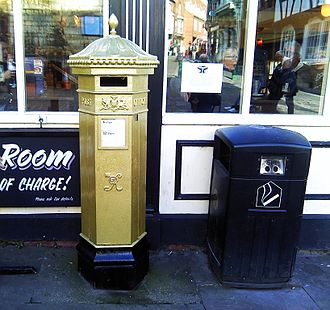 The Gold Victorian-style Penfold post box in Lincoln painted in recognition of Paralympian Sophie Wells who won the gold medal in the team Equestrian event at the 2012 Paralympic Games in London. It is the only post box painted gold in the county Lincoln Gold Postbox.jpg