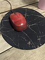 Logitech Red mouse on a mouse pad.jpg