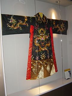 Robe loose-fitting outer garment, worn in many historical periods and contexts