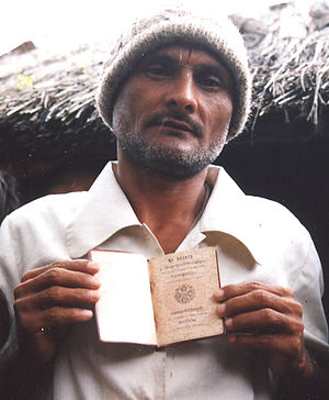 Bhutanese passport -  A Lhotshampa man holding his Bhutanese passport