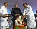 M. Venkaiah Naidu paying floral tributes to Didi Nirmala Deshpande at an event to rededicate Thakkar Bapa Vidyalaya.jpg