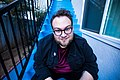 Magician Kyle Marlett sitting on blue steps.jpg