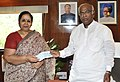 Mallikarjun Kharge receiving a cheque of Rs 10 lakh from the President, Railway Women's Welfare Central Organisation (RWWCO), Smt. Poonam Mittal.jpg