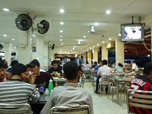 Mamak stall - Malaysian Mamak restaurants may also include hanging televisions and misting fan systems.